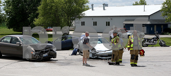 Rob Winner – rwinner@daily-chronicle.com<br /> Emergency personnel finish up helping out at an accident involving three cars and a motorcycle at Route 64 and McGough Road near Sycamore Speedway on Friday afternoon.<br /> 07/03/2009