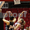 Beck Diefenbach  -  bdiefenbach@daily-chronicle.com<br /> <br /> Akron forward Kara Murphy (24) goes up against Northern Illinois guard Kylie York (3) during the first half of the game at Northern Illinois' Convocation Center in DeKalb, Ill., on Wednesday Feb. 4, 2009.