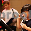 "Beck Diefenbach  -  bdiefenbach@daily-chronicle.com<br /> <br /> Grace Cho, 6, sings during band practice for ""The Reborn"" at the Salvation Army in DeKalb, Ill., on Wednesday Sept. 23, 2009."