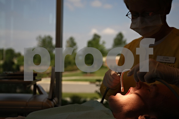 """Beck Diefenbach  -  bdiefenbach@daily-chronicle.com<br /> <br /> Dental hygienist Joan Kaul cleans the teeth of Clay Campbell, of Sycamore, during a visit to Collins Dental Group in Sycamore, Ill., on Thursday June 11, 2009. """"I probably grind (my teeth),"""" Campbell said. """"But I just try to get here ever six months."""""""