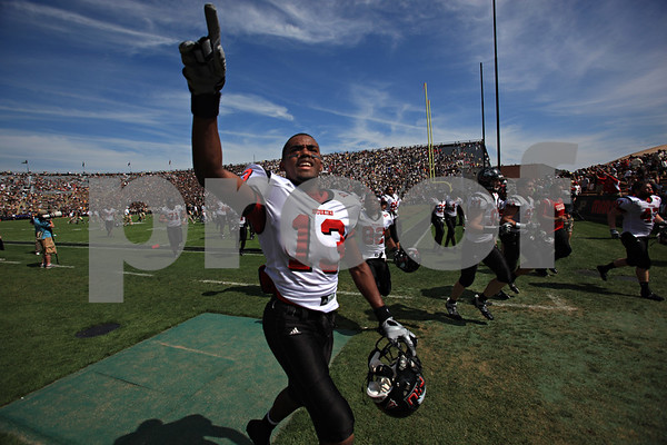 Beck Diefenbach – bdiefenbach@daily-chronicle.com<br /> <br /> Northern Illinois' Anthony Johnson (13) comes off the field with his team following the first half of the game against Purdue University in West Lafayette, Ind., on Saturday Sept. 19, 2009