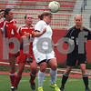 Randi Stella – rstella@daily-chronicle.com<br /> <br /> Sycamore's Brittni Brown (center) blocks the ball from Chatham Glenwood's Ashley Kulavic (4), Annie Kwedar (11), and Cara Moody (1) during the 2A third place state tournament game at North Central College in Naperville, Ill., on Saturday, June 6th, 2009.