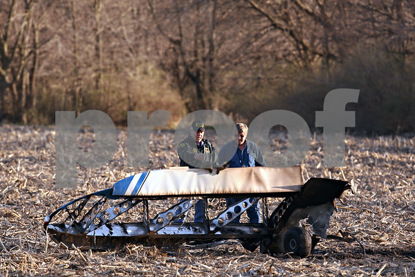 Beck Diefenbach  -  bdiefenbach@daily-chronicle.com<br /> <br /> Federal Aviation Administration officials inspect the crash site of a 415C Aircoupe which killed the two people inside in Sandwich, Ill., on Saturday April 11, 2009. Randall Hougham, the pilot and owner, and passenger Lauren Hamilton were both killed in the crash.