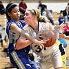 Beck Diefenbach  -  bdiefenbach@daily-chronicle.com<br /> <br /> Sycamore center Jessica Pluhm (31) elbows her way around Burlington Central center Brenda Thasavong (50) during the second quarter of the Kaneland Regional Semi Final game at Kaneland High School in Maple Park, Ill., on Tuesday Feb. 17, 2009.