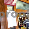 Beck Diefenbach – bdiefenbach@daily-chronicle.com<br /> <br /> Post Office Clerk Karen Phillips works behind the counter at the Waterman Post Office in Waterman, Ill., on Tuesday March 10, 2009. Delivery service may be cut from six days to five in hopes of reduced spending.