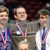 Beck Diefenbach – bdiefenbach@daily-chronicle.com<br /> <br /> From left, Hinckley-Big Rock's Tess Godhardt, head coach Greg Burks and manager Chris Stola pose for photos after defeating Winchester West Central in the Class 1A State Championship at the Redbird Arena in Normal, Ill., on Saturday Feb. 28, 2009.
