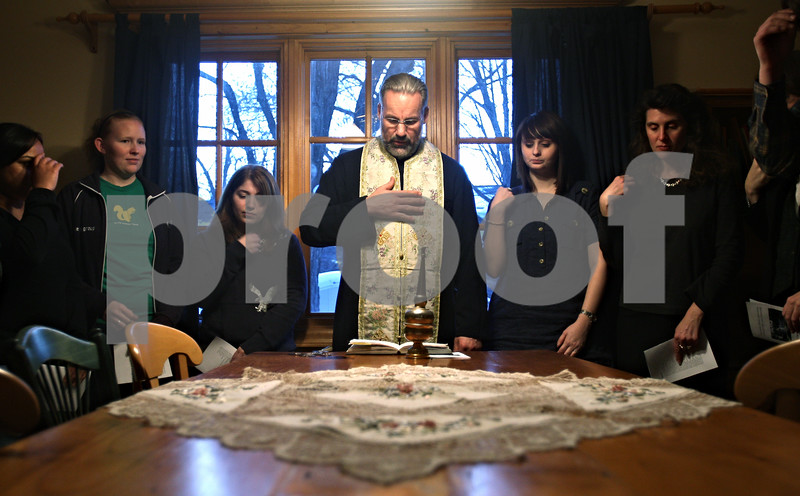 Beck Diefenbach  -  bdiefenbach@daily-chronicle.com<br /> <br /> Center, Father Chris Webb begins the house blessing ceremony at the Orthodox Christian Fellowship House in DeKalb, Ill., on Wednesday Jan 28, 2009.