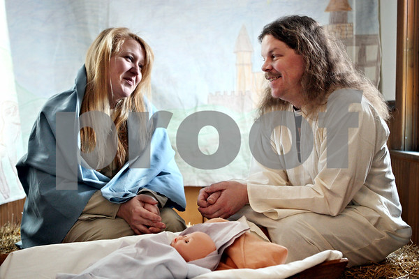 """Rob Winner – rwinner@daily-chronicle.com<br /> Jen Thompson, of Sycamore, and her husband, Bob, recreate the nativity scene during """"A Night In Bethlehem"""" at Cortland United Methodist Church on Saturday December 12, 2009 in Cortland, Ill."""