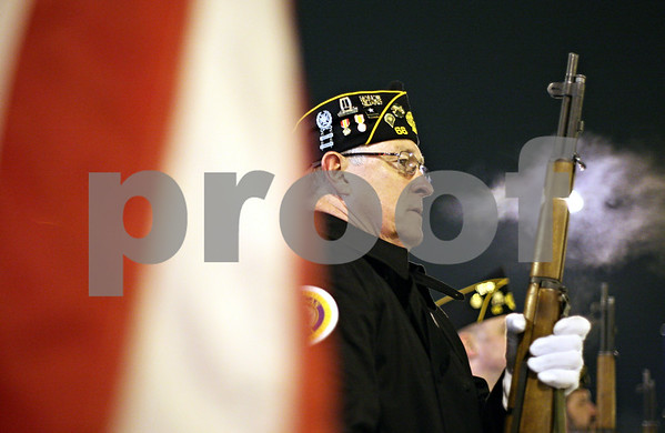 Beck Diefenbach  -  bdiefenbach@daily-chronicle.com<br /> <br /> American Legion Post 66 Honor Guard member Randy Smith, of DeKalb, stands at attention during a twenty one gun salute for the memorial anniversary of the bombings of Pearl Harbor in downtown DeKalb, Ill., on Monday Dec. 7, 2009.