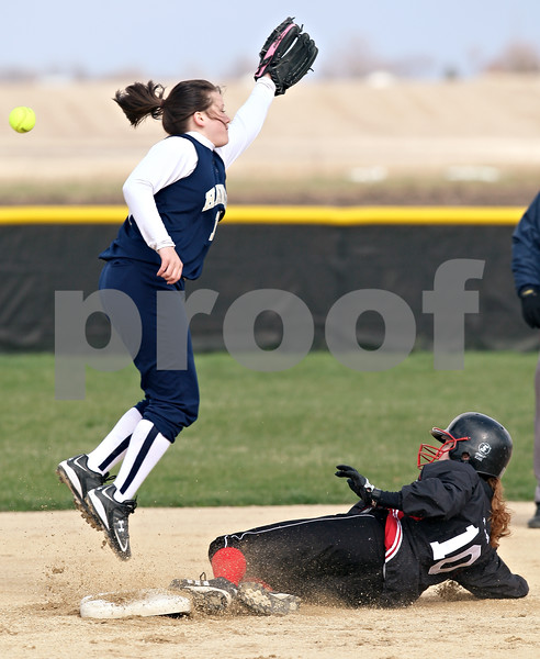 Beck Diefenbach  -  bdiefenbach@daily-chronicle.com<br /> <br /> Indian Creek's Jen Westbrook (10) arrives safe at second base as the ball flies past Hiawatha Kaitlin Tamraz (14) during the first inning of the game at Indian Creek High School in Shabbona, Ill., on Monday April 20, 2009.
