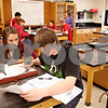 Beck Diefenbach  -  bdiefenbach@daily-chronicle.com<br /> <br /> Sophomore Keri Treml, left, and junior Bret Snow work together to identify and classify the three main types of rock samples given to them during science class at Sycamore High School in Sycamore, Ill., on Thursday Dec. 3, 2009.