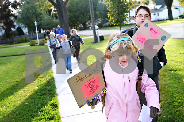 Beck Diefenbach  -  bdiefenbach@daily-chronicle.com<br /> <br /> Somonauk 1st grader Katelynn Tripp walks with other classmates to school as part of National Walk to School Day in Somonauk, Ill., on Wednesday Oct. 7, 2009.