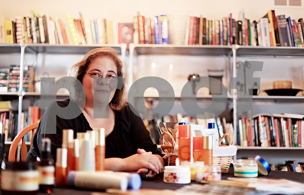 Beck Diefenbach  -  bdiefenbach@daily-chronicle.com<br /> <br /> In addition to her full-time officer managing job. Jeannie Hoffman, of Cortland, Ill., works part time as an independent consultant with Arbonne International while her husband looks for work as an architect.