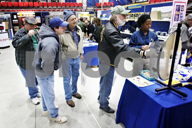 Beck Diefenbach  -  bdiefenbach@daily-chronicle.com<br /> <br /> Edward Kelly, of Boone County, Ill., spins the prize wheel at the NAPA Auto Parts booth during the 27th Annual Northern Illinois Farm Show at the Northern Illinois University Convocation Center in DeKalb, Ill., on Wednesday Jan. 7, 2009. Kelly won a screw driver.