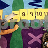 Beck Diefenbach  -  bdiefenbach@daily-chronicle.com<br /> <br /> North Elementary School kindergartner Jaly Polichnowski, left, lines up  dominoes under their totaled number during class in Sycamore, Ill., on Friday Sept. 25, 2009.