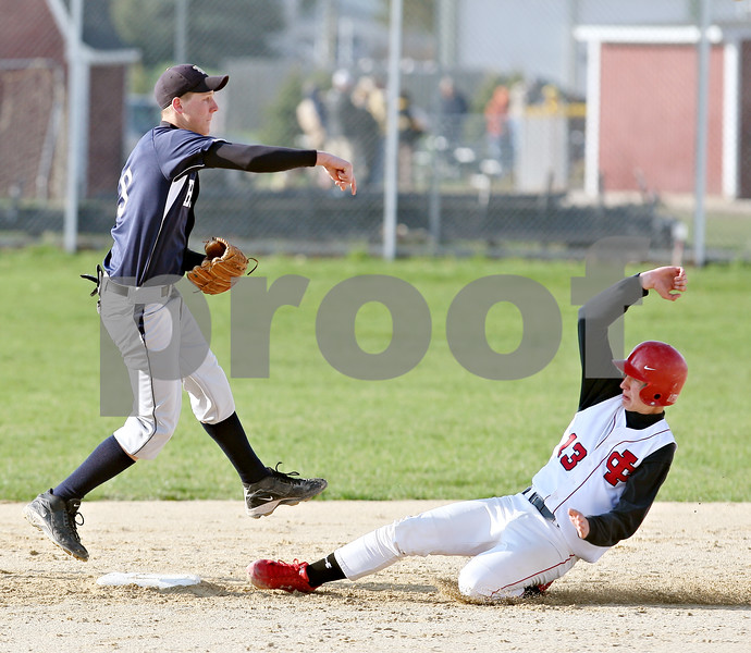 Beck Diefenbach  -  bdiefenbach@daily-chronicle.com<br /> <br /> Indian Creek's Danny Jensky (13) is out at second base as Hiawatha's Floyd Webster (9) tries for the double play and throws to first base during the fourth inning of the game at Indian Creek High School in Shabbona, Ill., on Monday April 20, 2009.