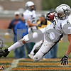 Rob Winner - rwinner@daily-chronicle.com<br /> <br /> Tyler Callaghan finds the end zone after a reception in the second quarter for Kaneland's third touchdown.<br /> <br /> 10/10/2009