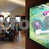 Beck Diefenbach  -  bdiefenbach@daily-chronicle.com<br /> <br /> An ariel photo of the Thorsen family's home hangs from the wall as the family sits down for dinner in the Waterman home on Friday April 10, 2009. Randy and Kay Thorsen want a wind turbine installed on their land.