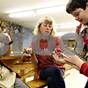 Wendy Kemp/For The Daily Chronicle<br /> Connie Handel, Outdoor Educator of Russell Woods, shows Jacob Handel, (left) Levi Moltz-Hohmann (center) and Eric Gilmore a snake during Saturday's class on nature.<br /> Genoa 8/29/09