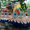 Rob Winner – rwinner@daily-chronicle.com<br /> Russ Barber, a pastor at the King's Mansion in Kingston, helps paddle a boat inspired by the biblical Noah's Ark, during the Kingston Kardboard Boat Regatta on Saturday afternoon.<br /> 07/25/2009