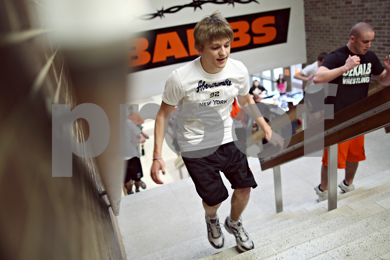 Beck Diefenbach – bdiefenbach@daily-chronicle.com<br /> <br /> DeKalb High School's Dominic Taylor hops stairs with the rest of his team during practice at DeKalb High School in DeKalb, Ill., on Tuesday March 10, 2009.