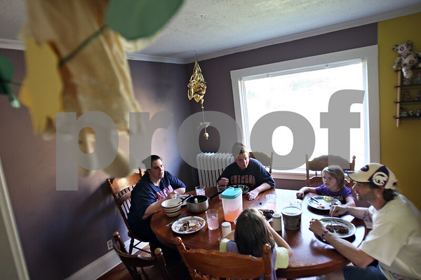 Beck Diefenbach  -  bdiefenbach@daily-chronicle.com<br /> <br /> The Edwards family sits down for dinner in their DeKalb home on Thursday May 21, 2009.