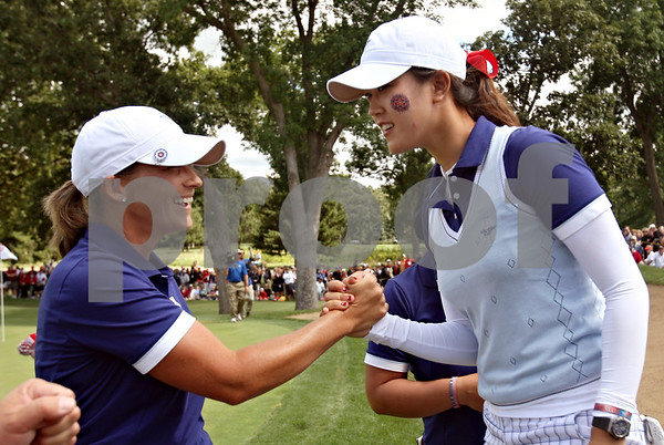 Beck Diefenbach  -  bdiefenbach@daily-chronicle.com<br /> <br /> USA's Michelle Wie (right) congratulates teammate Angela Stanford after Stanford finished the 14th hole against team Europe at the Solheim Cup in Sugar Grove, Ill., on Saturday Aug. 22, 2009.