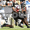 Beck Diefenbach – bdiefenbach@daily-chronicle.com<br /> Northern Illinois' Martel Moore (1) is taken down by Purdue's Royce Adams (10) during the fourth quarter of the game in West Lafayette, Ind., on Saturday Sept. 19, 2009. NIU defeated Purdue 28 to 21.