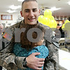 Rob Winner – rwinner@daily-chronicle.com<br /> Army Pfc. Wesley Wisz is greeted with a hug by family friend Carmyn Tassone, of Sandwich, at the VFW Post 1486 in Sandwich, Ill. on Wednesday December 23, 2009.