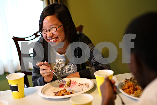 Beck Diefenbach  -  bdiefenbach@daily-chronicle.com<br /> <br /> Ngoc Bich, of Vietnam, shares a laugh during a Thanksgiving dinner for international students at the Riley's home in Sycamore, Ill., on Thursday Nov. 26, 2009.