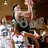 Beck Diefenbach – bdiefenbach@daily-chronicle.com<br /> <br /> DeKalb center Jordan Threloff (42) grabs a rebound over South Elgin guard Erik Stade (25) during the first quarter of the Class 4A regional semi-final game at DeKalb High School in DeKalb, Ill., on Wednesday March 4, 2009.