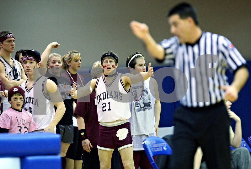 Beck Diefenbach – bdiefenbach@daily-chronicle.com<br /> <br /> Dakota High School students and fans react after the referee gives possesion of the ball to Hinckley-Big Rock during the third quarter of the 1A Super Sectional game at Elgin Community College in Elgin, Ill., on Monday Feb. 23, 2009.