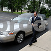 Rob Winner – rwinner@daily-chronicle.com<br /> Clay Kloster of Quiram Funeral Chapels in Sycamore prepares a hearse this past Saturday morning before a service.<br /> 08/01/2009