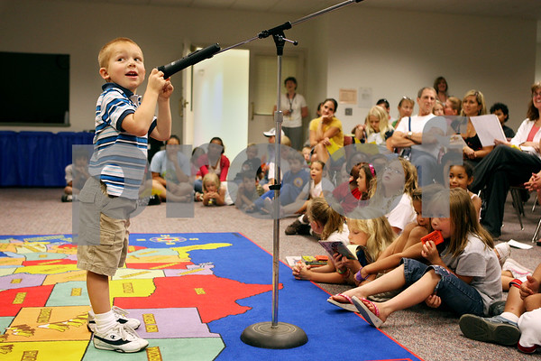 Rob Winner – rwinner@daily-chronicle.com<br /> During a talent show at the Sycamore Public Library on Thursday afternoon, Daniel Martin, 3, finishes up his performance by singing the alphabet backwards.<br /> 07/23/2009