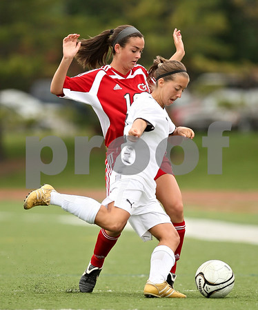 Beck Diefenbach  -  bdiefenbach@daily-chronicle.com<br /> <br /> Sycamore's Mary Kohler (front) and Cathum Glenwood's Ali Traina (back) during the first half of the Class 2A third place tournament game at North Central College in Naperville, Ill., on Saturday June 6, 2009. Sycamore lost 1 to 2, taking fourth place in the tournament.