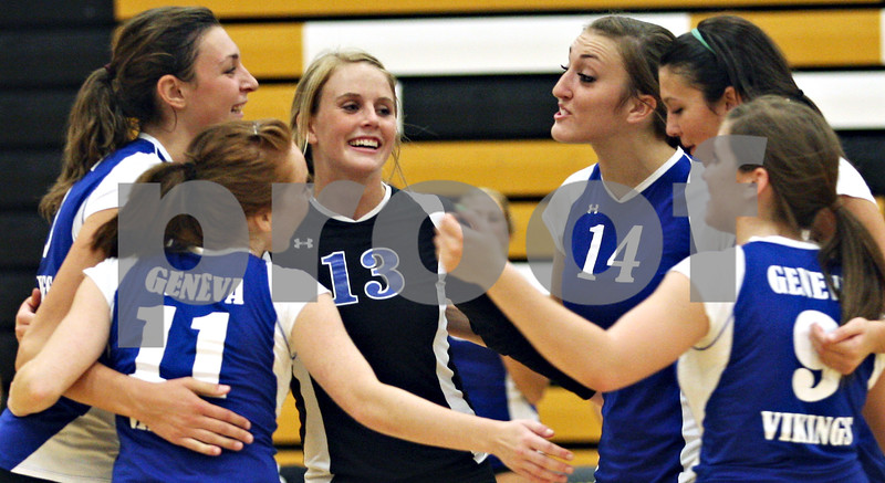 Beck Diefenbach  -  bdiefenbach@daily-chronicle.com<br /> <br /> The Geneva volleyball team celebrates after defeating Sycamore 2-0 at Sycamore High School in Sycamore, Ill., on Thursday Sept. 17, 2009.