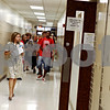 Rob Winner – rwinner@daily-chronicle.com<br /> Shirley Hunt, a counselor at DeKalb High School, leads a group of incoming freshmen through the building during an orientation on Tuesday morning.<br /> 08/11/2009