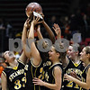 Beck Diefenbach  I  bdiefenbach@daily-chronicle.com<br /> <br /> The Sycamore girls basketball team reacts after receiving their trophy for beating DeKalb High School at the Northern Illinois University Convocation Center in DeKalb, Ill., on Friday Jan. 30, 2009.