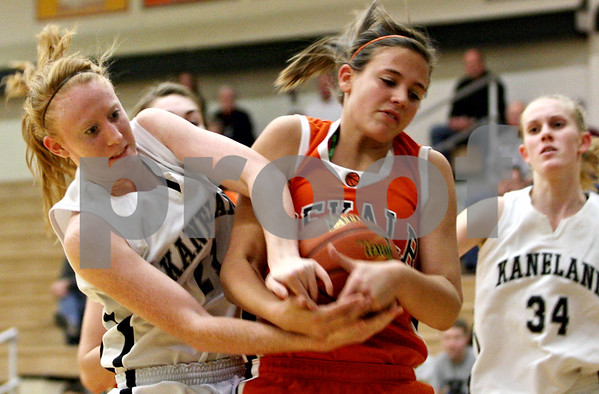 Rob Winner – rwinner@daily-chronicle.com<br /> Rob Winner – rwinner@kcchronicle.com<br /> Kaneland's Mallory Carlson and DeKalb's Kelli Gerace battle for possession during the second quarter of their game on Friday night at Kaneland.<br /> 12/04/2009