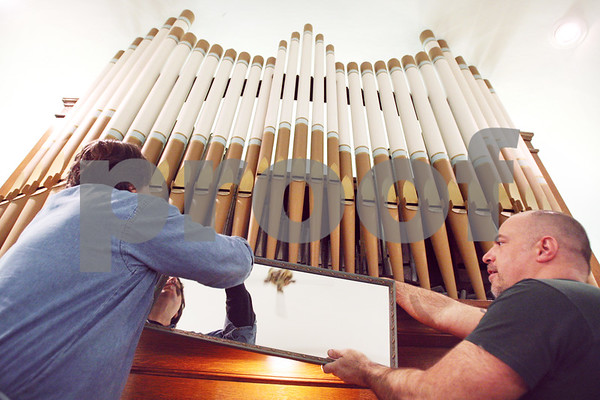 Beck Diefenbach  -  bdiefenbach@daily-chronicle.com<br /> <br /> Organ service technicians Paul Szymkowski, left, and Stephan Drexler, of Berghaus Pipe Organ Builders, remount the mirror after working on the pipe organ at St. Mary's of the Assumption Church in Maple Park, Ill., on Friday March 20, 2009.  Szymkowski and Drexler was tuning the organ in preparation of the future performance.