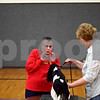 Beck Diefenbach  -  bdiefenbach@daily-chronicle.com<br /> <br /> Dog trainer Marcia Poff, left, ties to grab the attention of Lilly, a Cavalier King Charles Spaniel, as the owner Denise Rudecki, of Kingston, tries to keep the dog still during a showmanship class at the Haish Gym in DeKalb, Ill., on Thursday March 26, 2009.