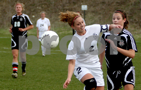 Rob Winner – rwinner@daily-chronicle.com<br /> Kaneland's Paige Rogers (2) and Indian Creek's Katie Hunt battle for possession during their first half of Thursday's game in Maple Park. Kaneland defeated Indian Creek 2-0.<br /> 04/23/2009