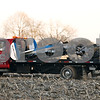 Beck Diefenbach  -  bdiefenbach@daily-chronicle.com<br /> <br /> The crashed remains of a 415C Aircoupe are hauled away from the crash site in Sandwich, Ill., on Saturday April 11, 2009. Randall Hougham, the pilot and owner, and passenger Lauren Hamilton were both killed in the crash.