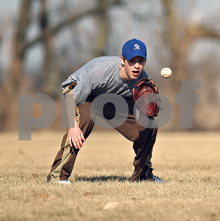 Beck Diefenbach  -  bdiefenbach@daily-chronicle.com<br /> <br /> Hinckley-Big Rock's Colton Craig catches the ball at shortstop during practice at HBR High School in Hinckley, Ill., on Monday March 16, 2009.