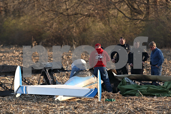 Beck Diefenbach  -  bdiefenbach@daily-chronicle.com<br /> <br /> DeKalb County Sheriffs officers and Federal Aviation Administration officials inspect the crash site of a 415C Aircoupe which killed the two people inside in Sandwich, Ill., on Saturday April 11, 2009. Randall Hougham, the pilot and owner, and passenger Lauren Hamilton were both killed in the crash.