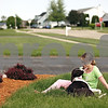 Beck Diefenbach  -  bdiefenbach@daily-chronicle.com<br /> <br /> Krystal Wilson, 11, exchanges kisses with her service dog, Bella, on the lawn of her Cortland home on Friday May 29, 2009.