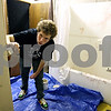 Rob Winner – rwinner@daily-chronicle.com<br /> <br /> Logan Woodbury, 16, paints a room underneath the stage at the Egyptian Theatre in DeKalb on Monday night for the Amenti Haunted House which is set to open on Thursday night.<br /> <br /> 10/19/2009