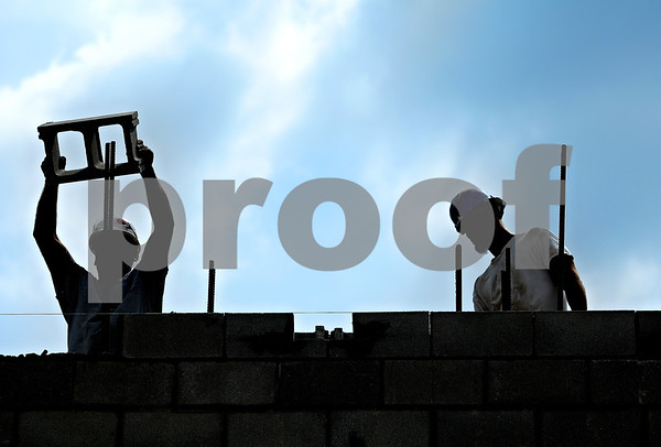 Beck Diefenbach  -  bdiefenbach@daily-chronicle.com<br /> <br /> Construction workers build the southeast  wall to the new DeKalb High School on Dresser Road in DeKalb, Ill., on Tuesday Sept. 8. 2009.