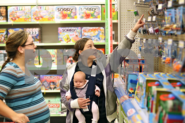 Beck Diefenbach  -  bdiefenbach@daily-chronicle.com<br /> <br /> Morgan Miller (center), of DeKalb, shops for toys with her 2 month old baby Melani while touring the rebuilt Target Store in DeKalb, Ill., on Tuesday Oct. 6, 2009.