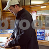 "Beck Diefenbach – bdiefenbach@daily-chronicle.com<br /> <br /> John Gilberth, of Waterman, goes through his mail after picking it up from the Waterman Post Office in Waterman, Ill., on Tuesday March 10, 2009. Delivery service may be cut from six days to five in hopes of reduced spending.  ""It's fine with me,"" said Gilberth concerning the possible canceling of one day of delivery service."